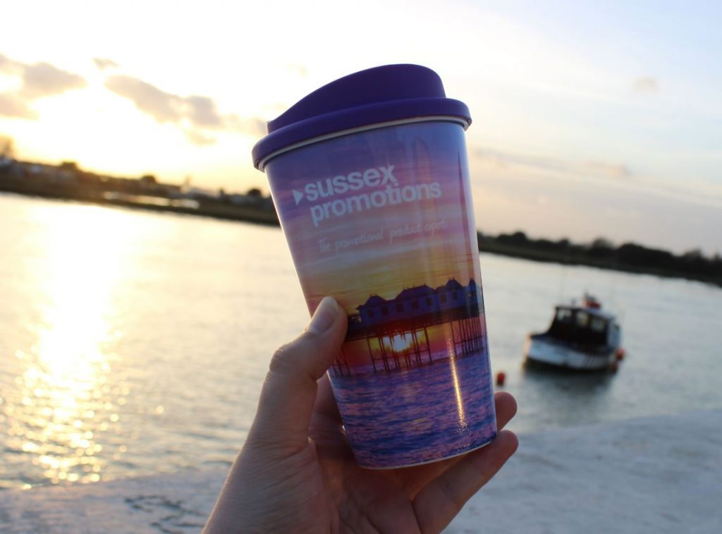Image shows a great example of eco promotional products - a branded Americano re-useable take-away coffee cup